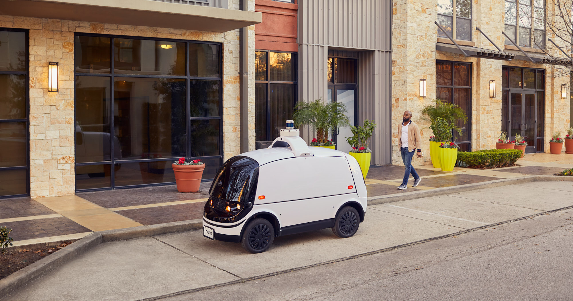Driverless Vehicle with Man and Sidewalk | Brand Lifestyle Photography
