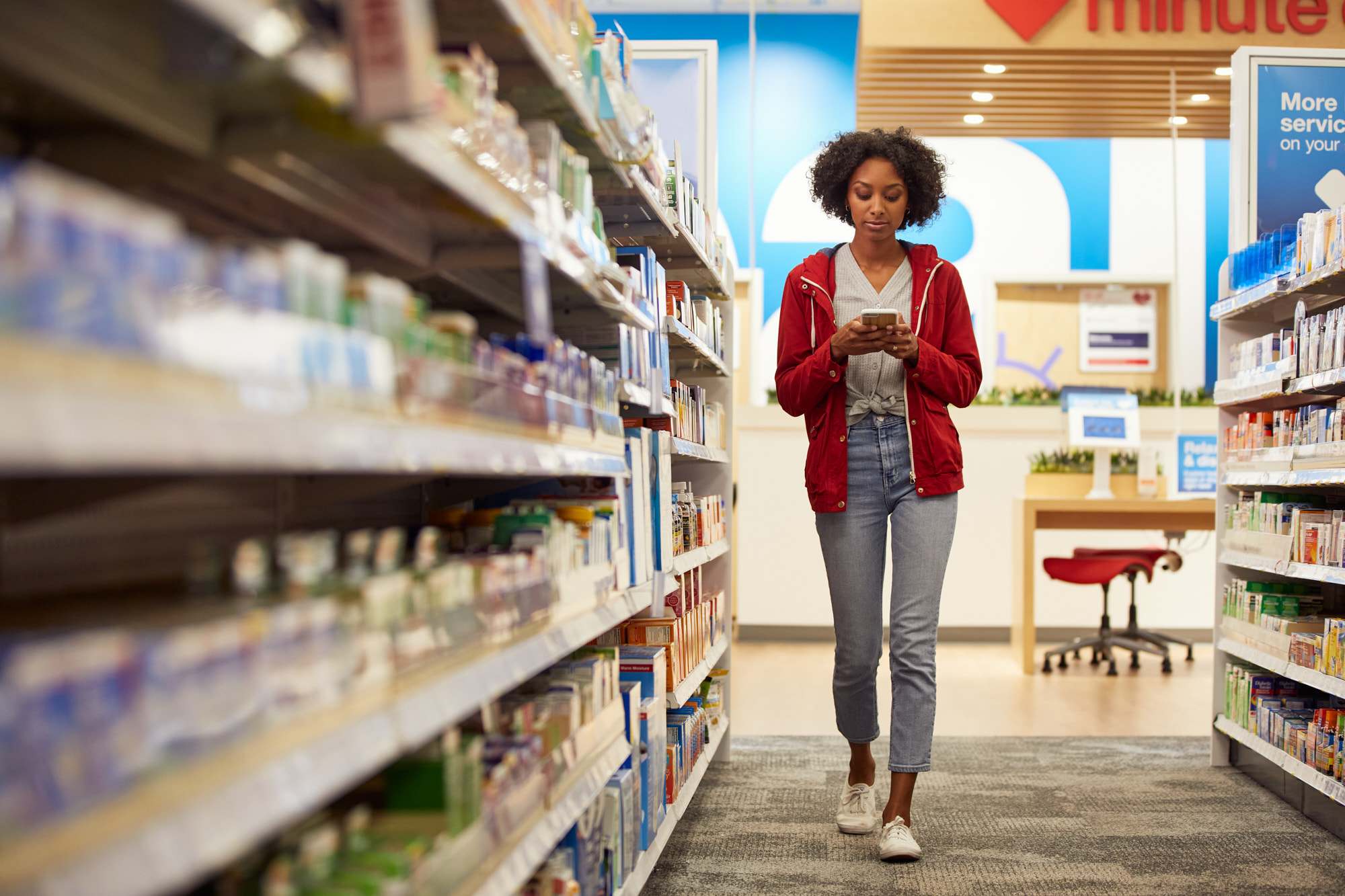 Young Woman in Pharmacy Aisle | Healthcare Lifestyle Photography